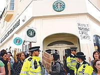 Protesters demonstrate outside the Starbucks in St James's Street in May
