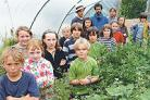 Food project volunteers with children from the nearby Steiner School who help out at the allotments