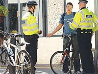 Police speak to a cyclist about safety issues