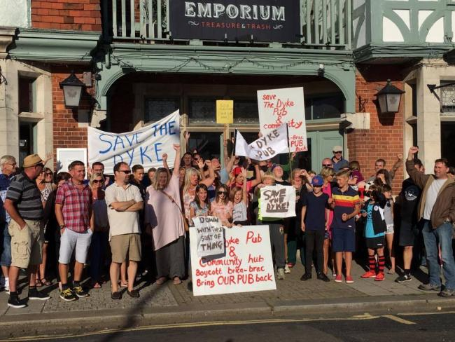 Save the Dyke protesting to keep the pub at the heart of the community