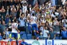 Jump for joy. Two-goal Glenn Murray celebrates scoring against Barnsley