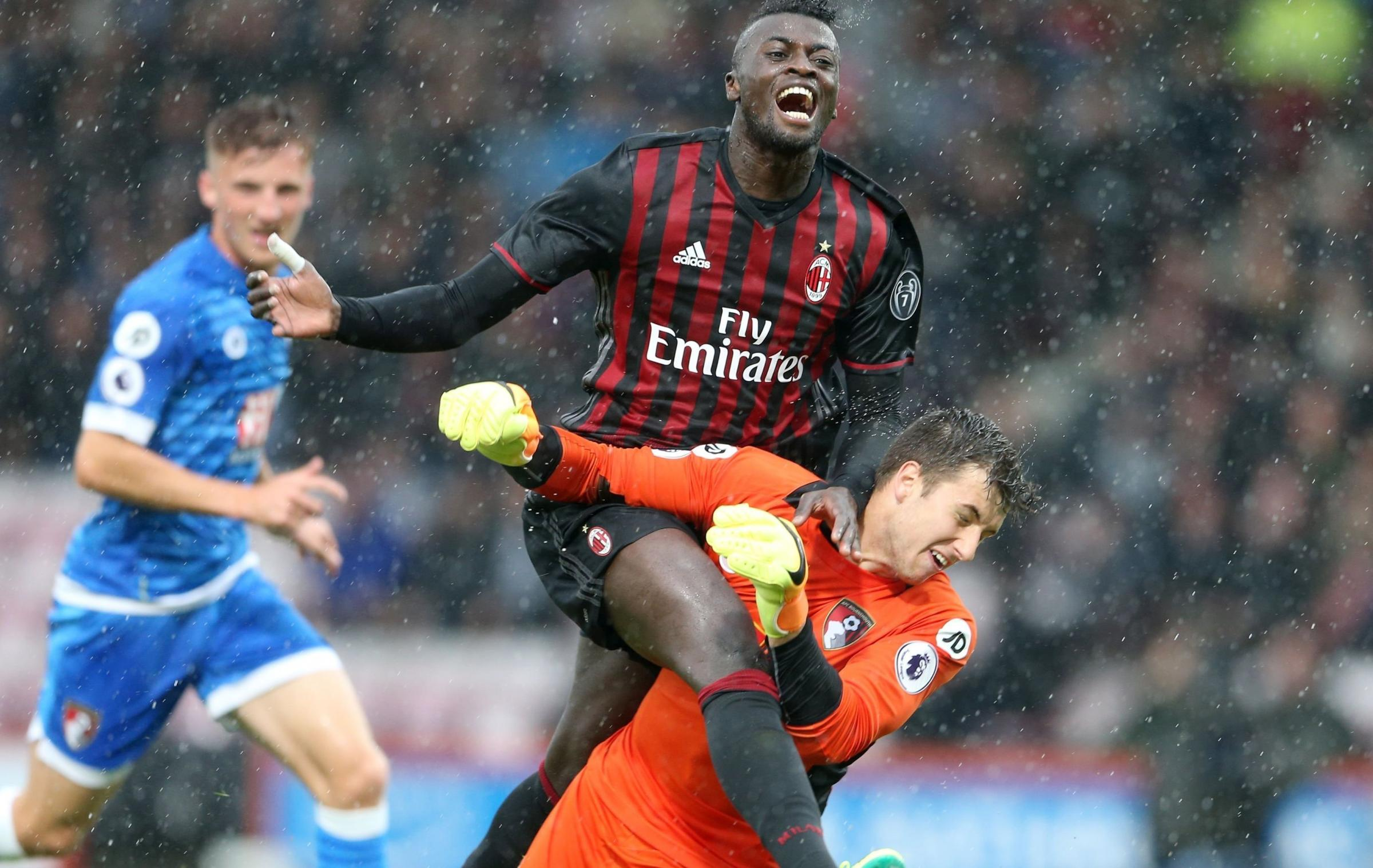 Jordan Holmes, Eastbourne Bororough's new goalkeeper, challenges Milan striker Mbaye Niang