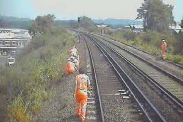 The train's CCTV camera shows Alan Evans (front of picture) walking along the side of the line prior to the incident
