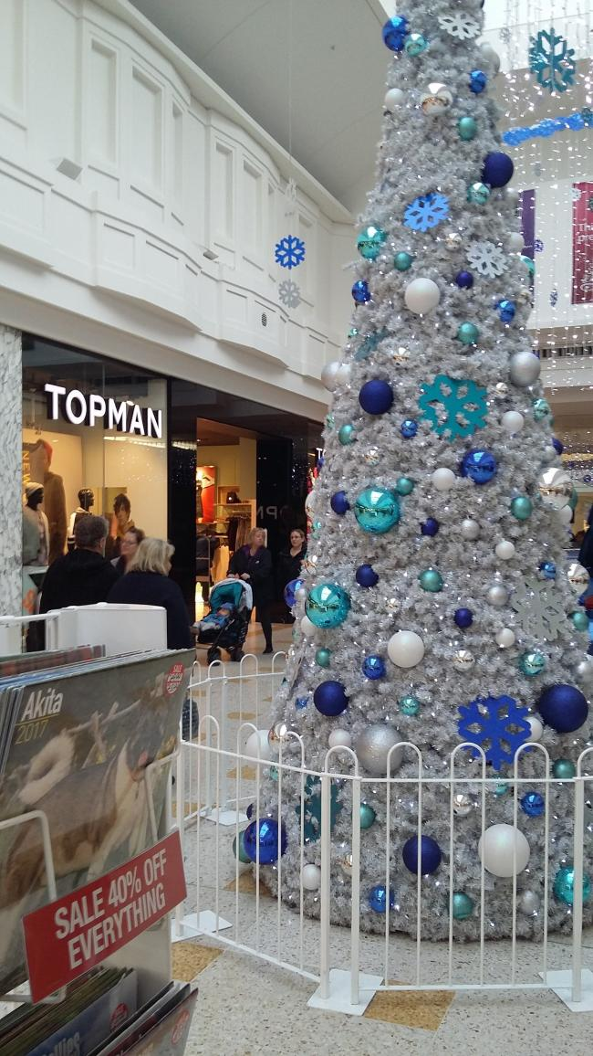 the christmas tree sitting proudly still in the midle of eastbournes arndale centre