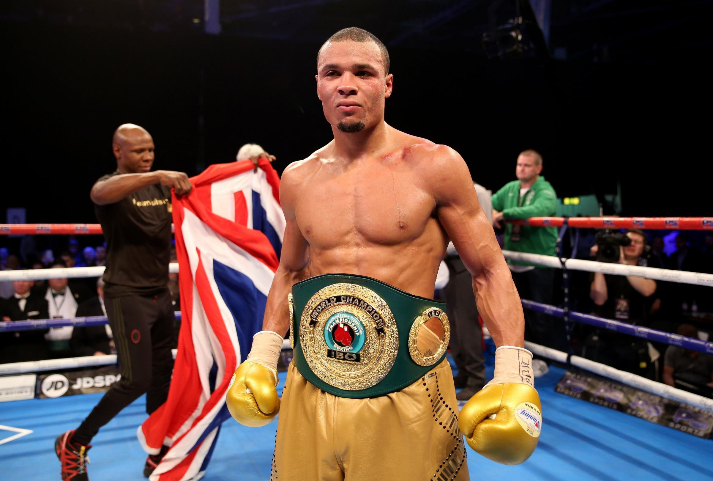 Chris Eubank junior shows off the world title belt after beating Renold Quinlan