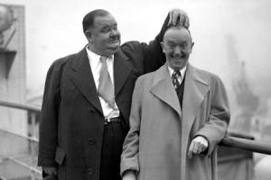 "File photo dated 10/2/1947 of Oliver Hardy scratching the head of Stan Laurel, as the famous pair pose on the ""Queen Elizabeth"" at Southampton. The comedy genius of Laurel and Hardy will be remembered today when a statue of the double act is unv"