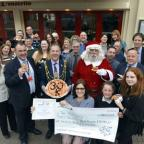 The Argus: Argus Appeal santa bus cheque presentation at Donatello's Brighton. ..Picture: Allan Hutchings.