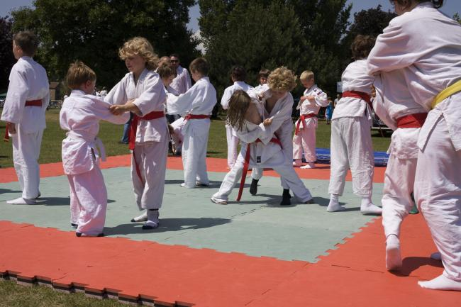 Young judokas who attend Brighton Judo Club practise their skills on mats