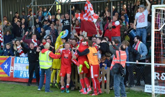 The celebration gets under way at Whitehawk.  Picture: David Pillman