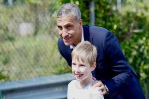 Chris Hughton poses with a young fan. Pictures by Simon Dack (simondack.co.uk)