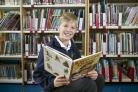 Wilf Jenkins won 500 books for his school Balfour Primary in Brighton.  Picture: David McHugh