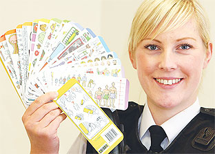 PC Emma Cruise shows off the picture cards being piloted in Arundel, Bognor and Littlehampton
