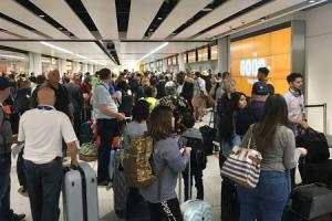 Handout photo taken with permission from the Twitter feed of @simonarmiger of queues at Gatwick Airport where some flights have had to depart without passengers' luggage due to a problem with the baggage system. PRESS ASSOCIATION Photo. Issue date: Fr
