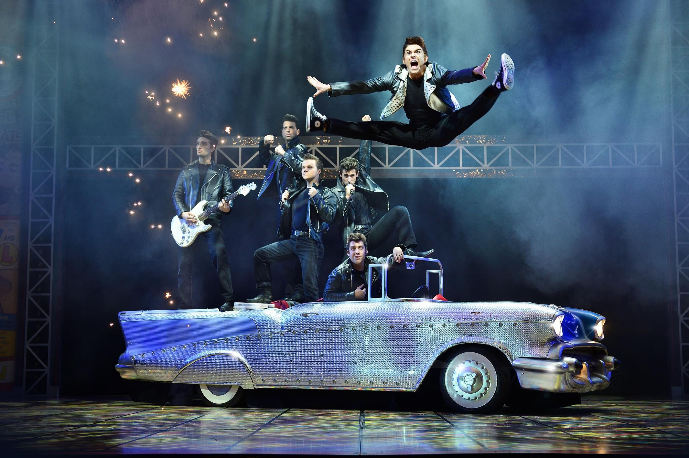 The cast of Grease performing Greased Lightning