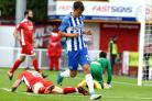 Solly March wheels away after scoring at Crawley. Picture by Liz Finlayson
