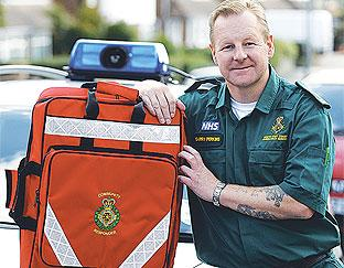 Paramedic Garry Perkins wrestled a gun from a man in a wheelchair who was demanding morphine