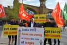 Rail unions and campaigners protest against rail fare increases outside King's Cross station
