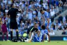 Izzy Brown receiving treatment against Manchester City. Picture Simon Dack
