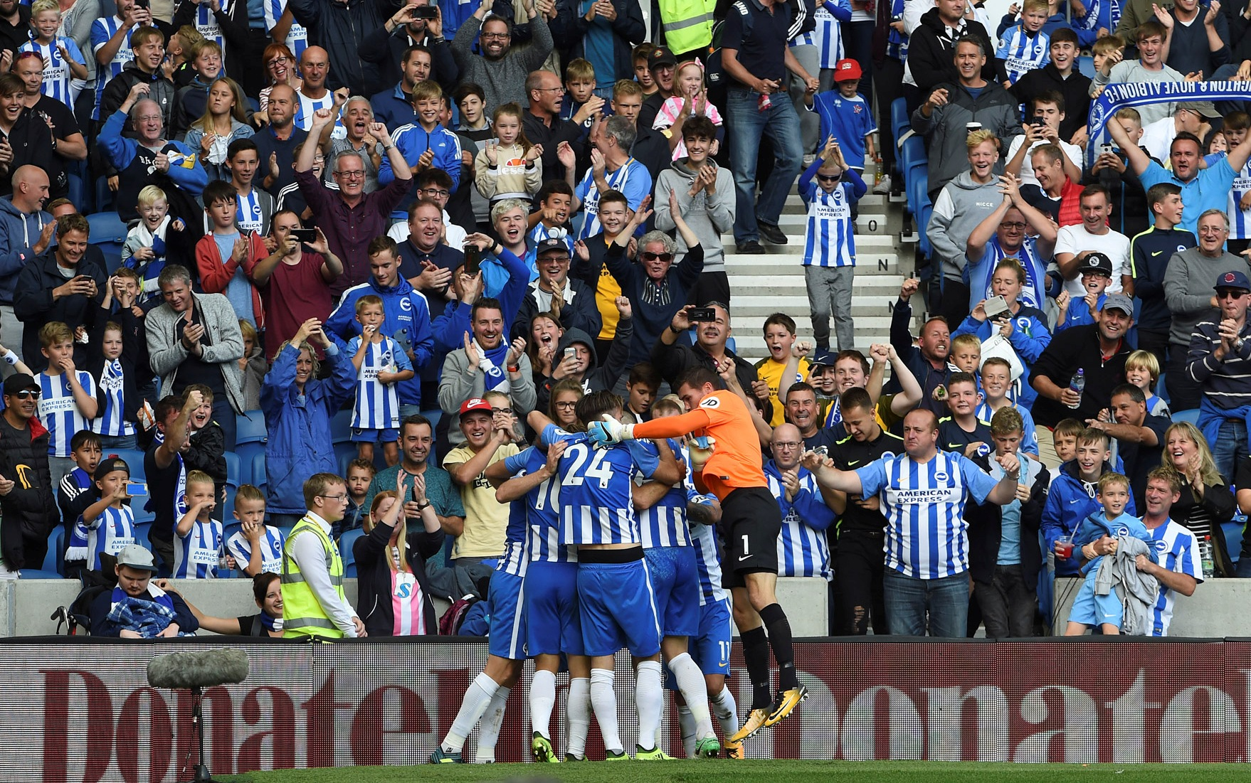 Fans and players celebrate at the Amex today. Picture by Liz Finlayson