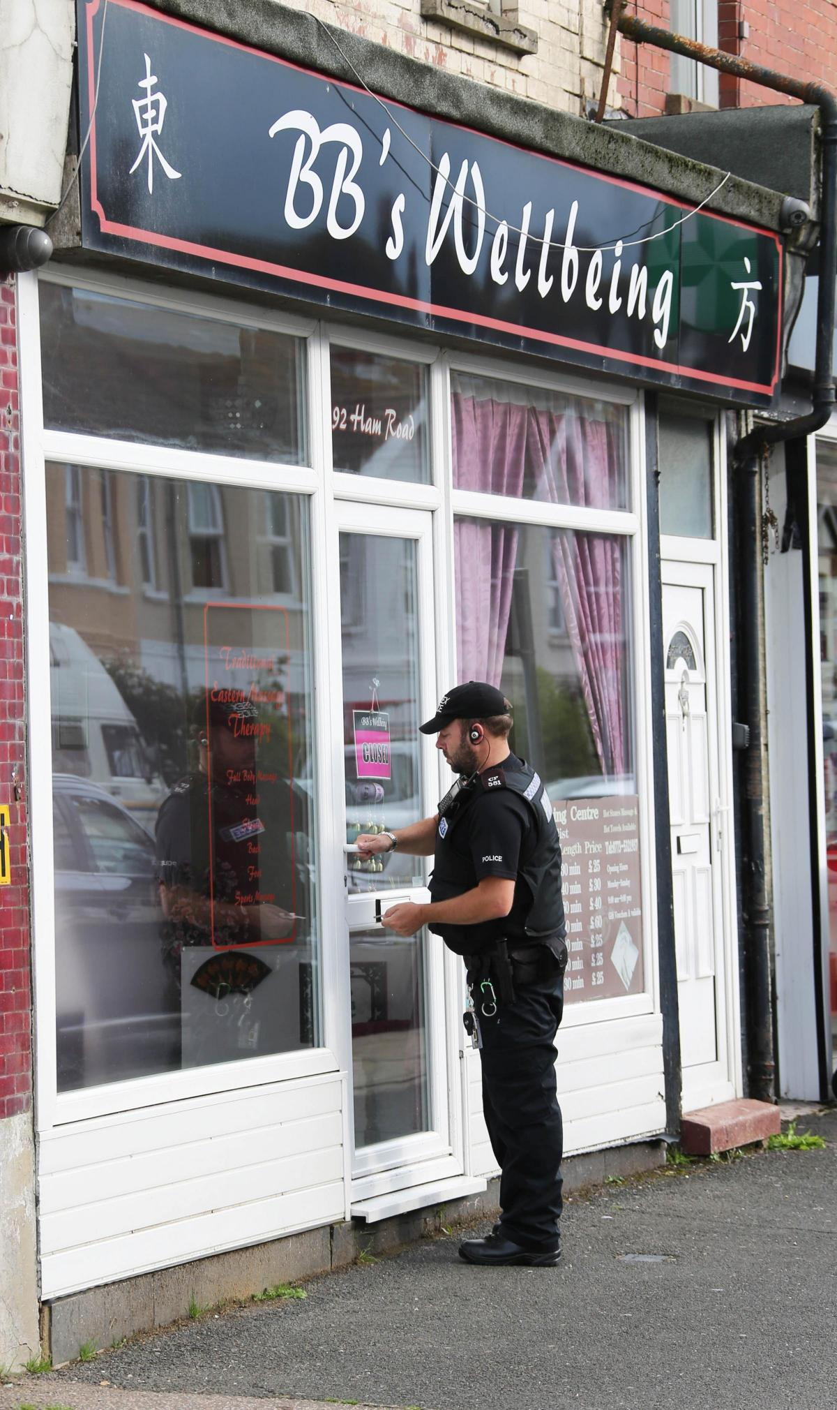 Massage parlours in sex trafficking raids