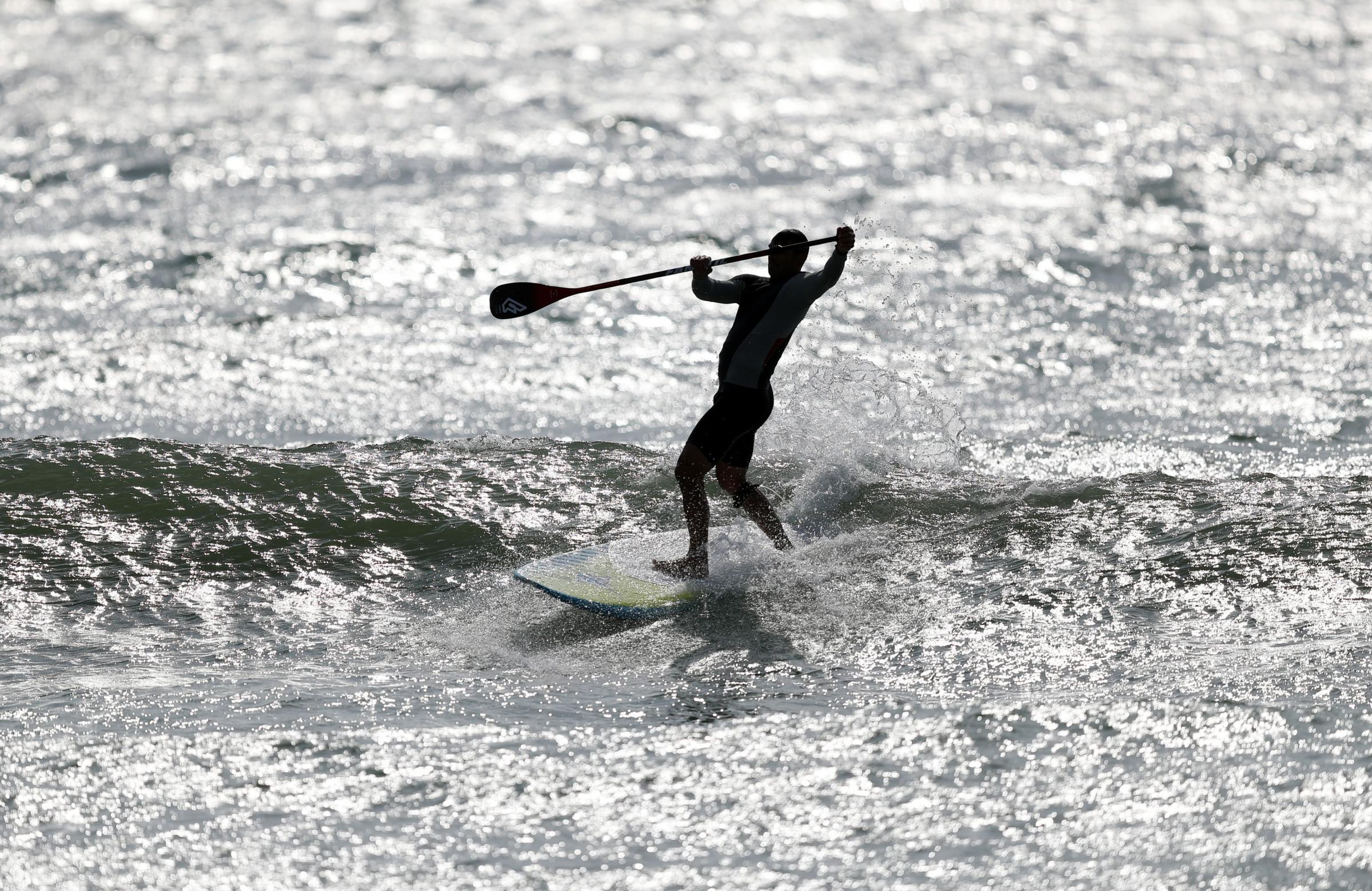 A paddle boarder off East Wittering beach.  Picture: Andrew Matthews/PA Wire