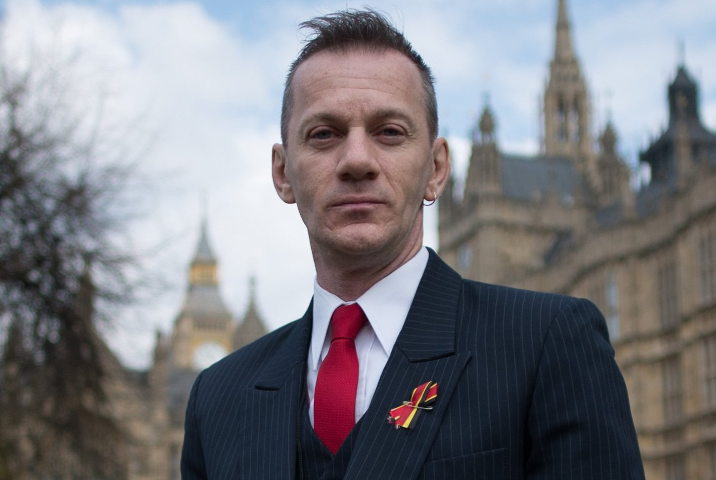 Blood transfusion scandal victim Mark Ward outside the Houses of Parliament in London