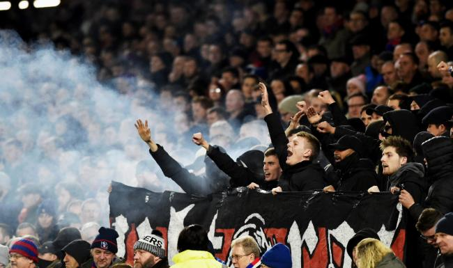 Palace fans let off smoke flares during the Premier League match between Brighton and Hove Albion and Crystal Palace at the Amex