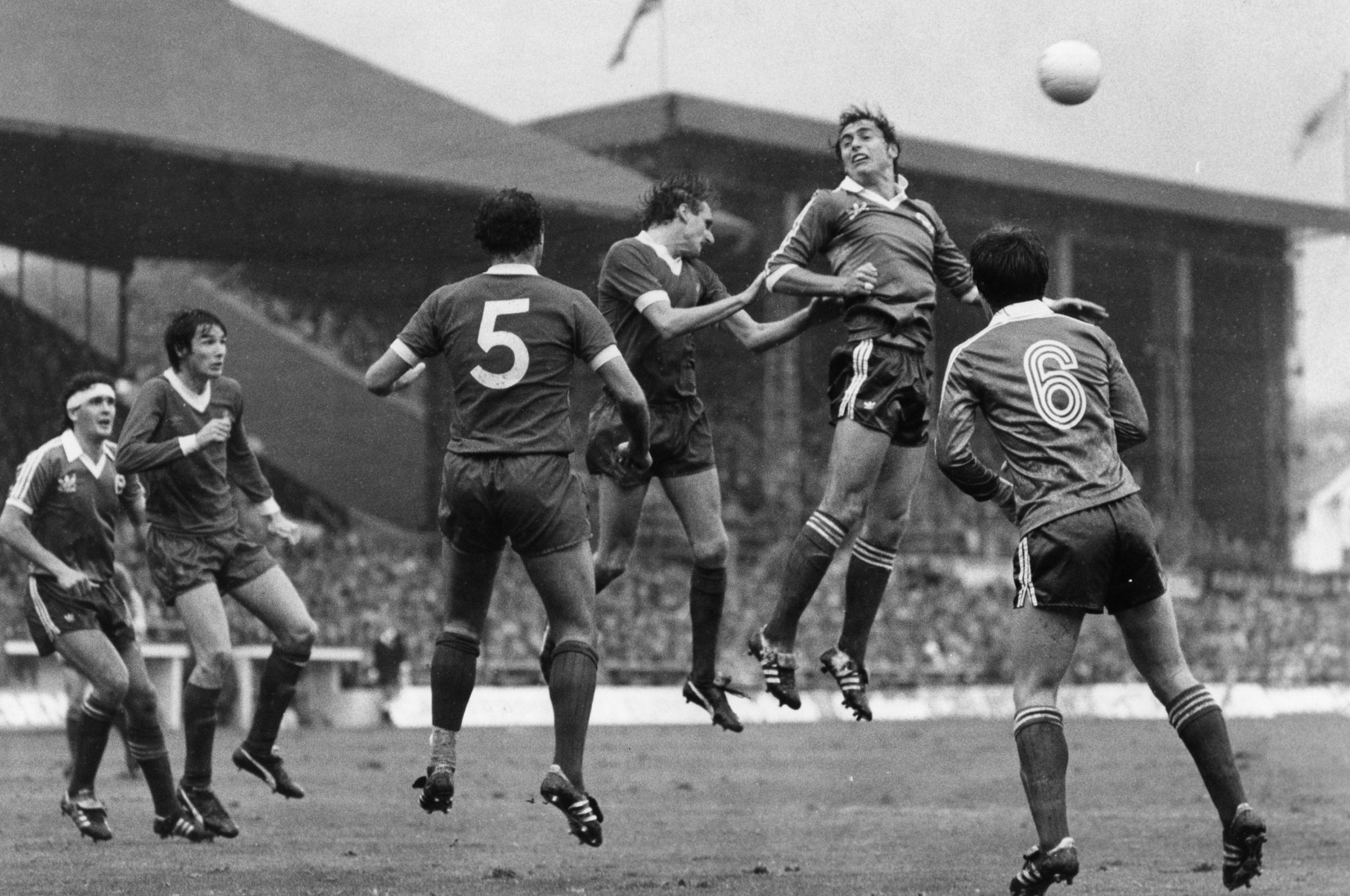 Phil Thompson and Michael Robinson compete in the air with Steve Foster, Alan Hansen, Ray Kennedy and Steve Gatting also in the picture