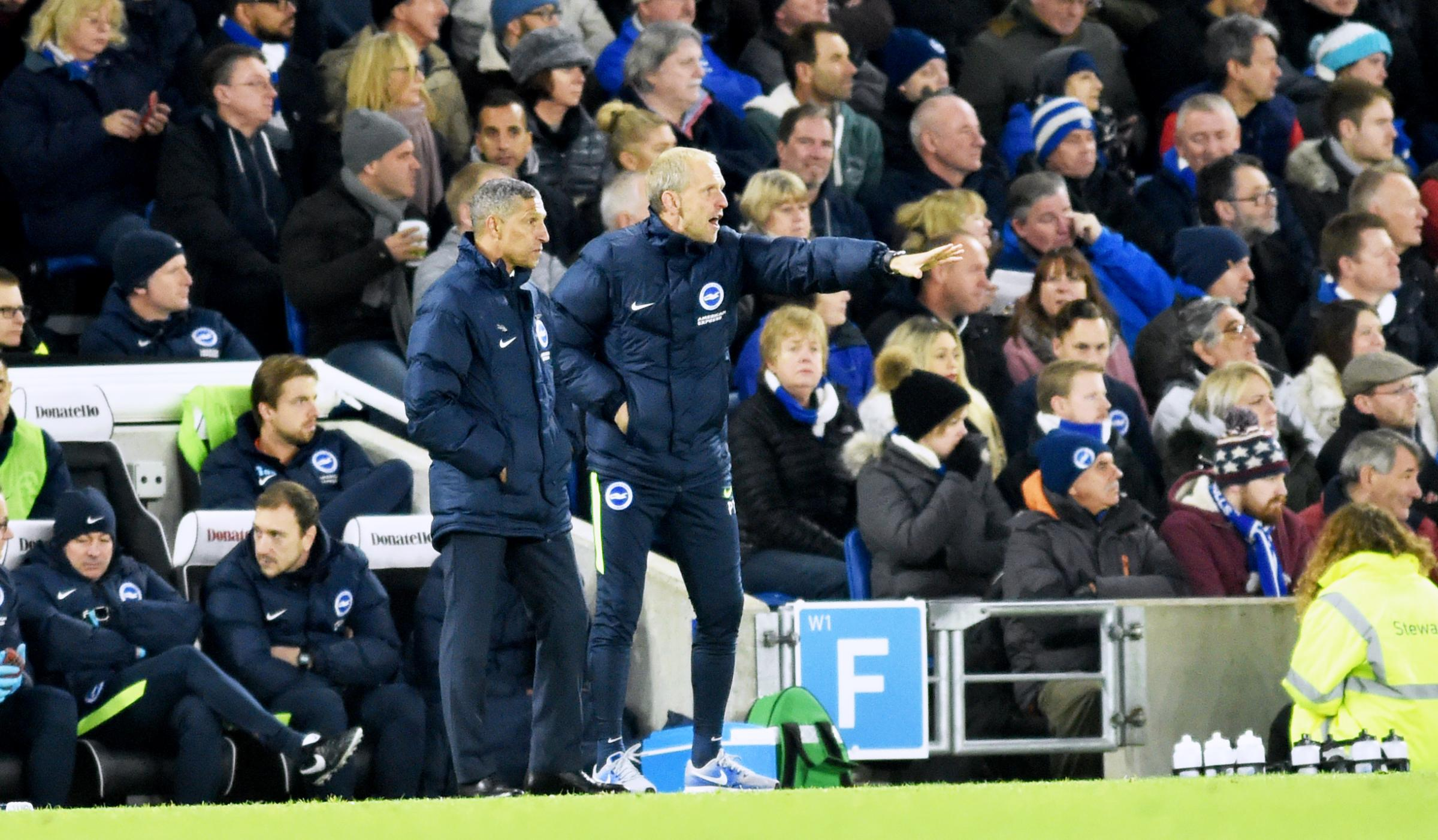 Plenty for Chris Hughton (left) and assistant Paul Trollope to ponder ahead of trips to Tottenham and Chelsea during a hectic period