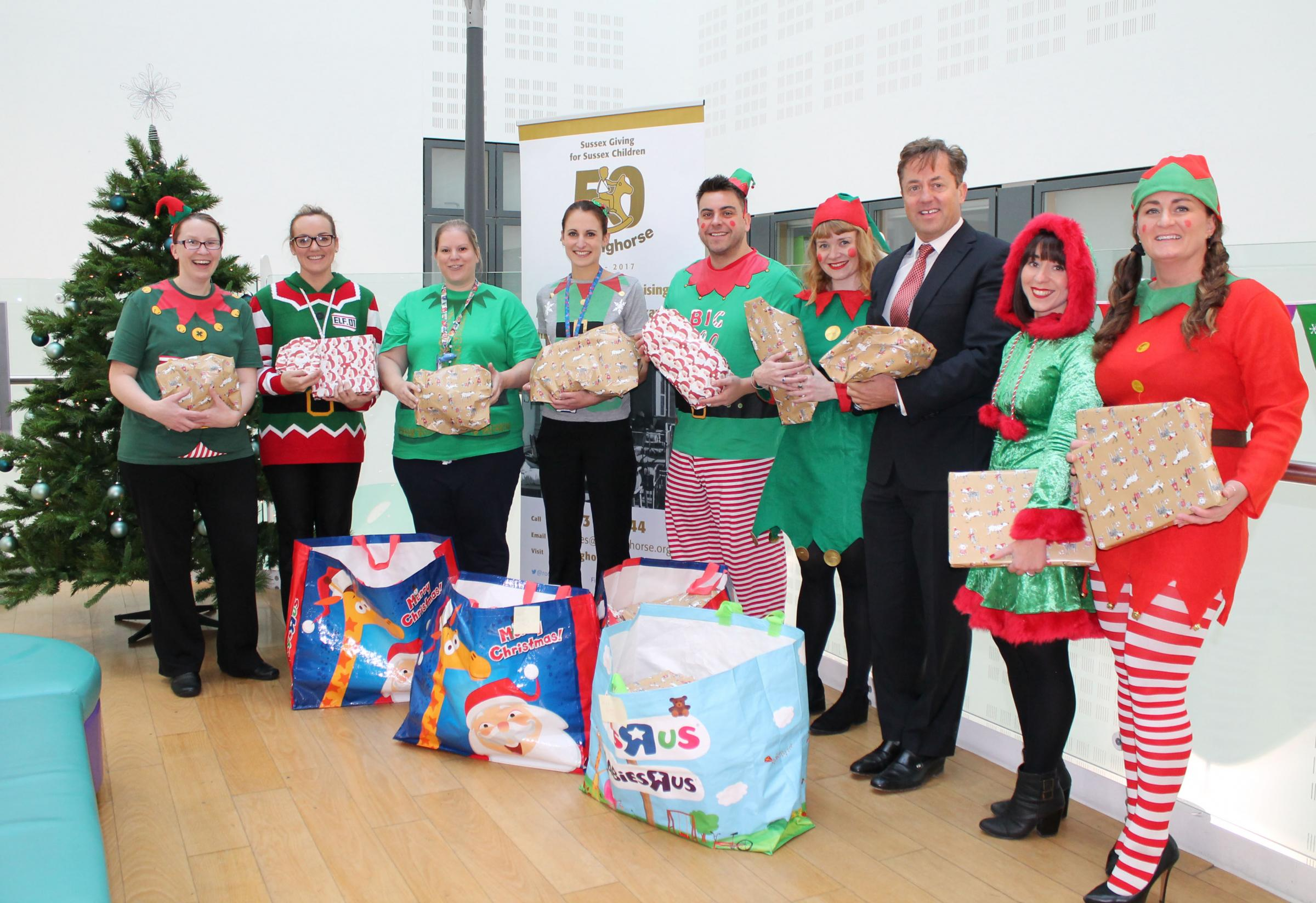 The team from Austin Rees join staff at the Royal Alexandra Children's Hospital to hand over presents they have donated