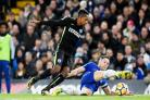 Jose Izquierdo tussles with Gary Cahill at Chelsea