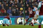 Manuel Lanzini scores West Ham's fourth goal against Huddersfield (Martin Rickett/PA)