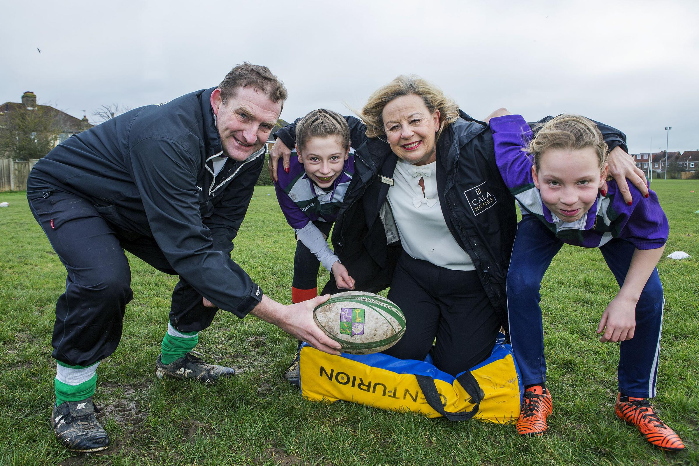 CALA Homes have donated money to Bognor Regis for Women's and Girls rugby facilities at the club. Irene Whitmarsh from CALA Homes seen here (centre) in a scrum with Steve Parsons and girls from the team Grace Callaway (left) and Lily Smith