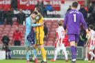 Mathew Ryan is hugged after the final whistle at Stoke
