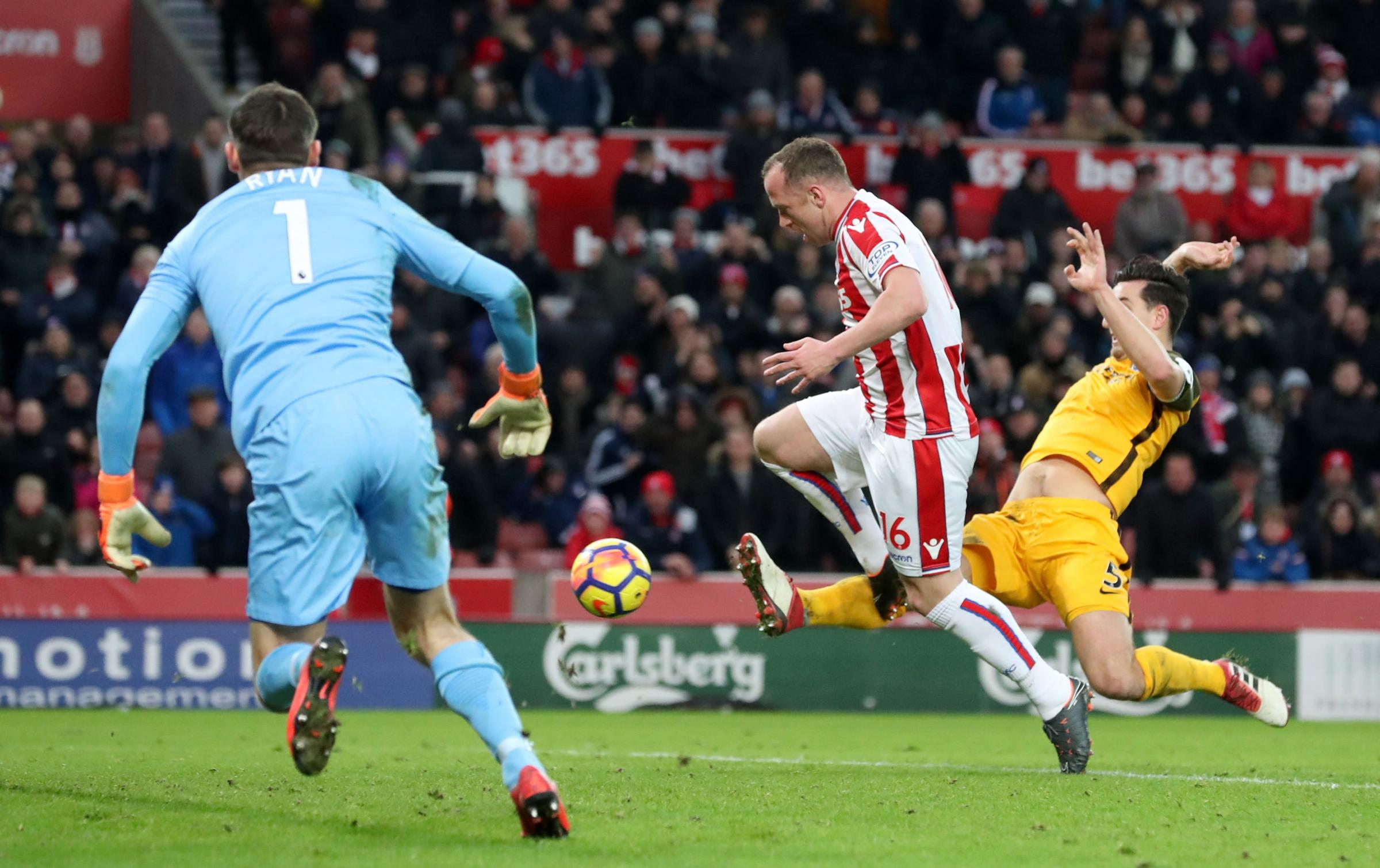 Lewis Dunk (right) denies Charlie Adam from the penalty rebound at Stoke