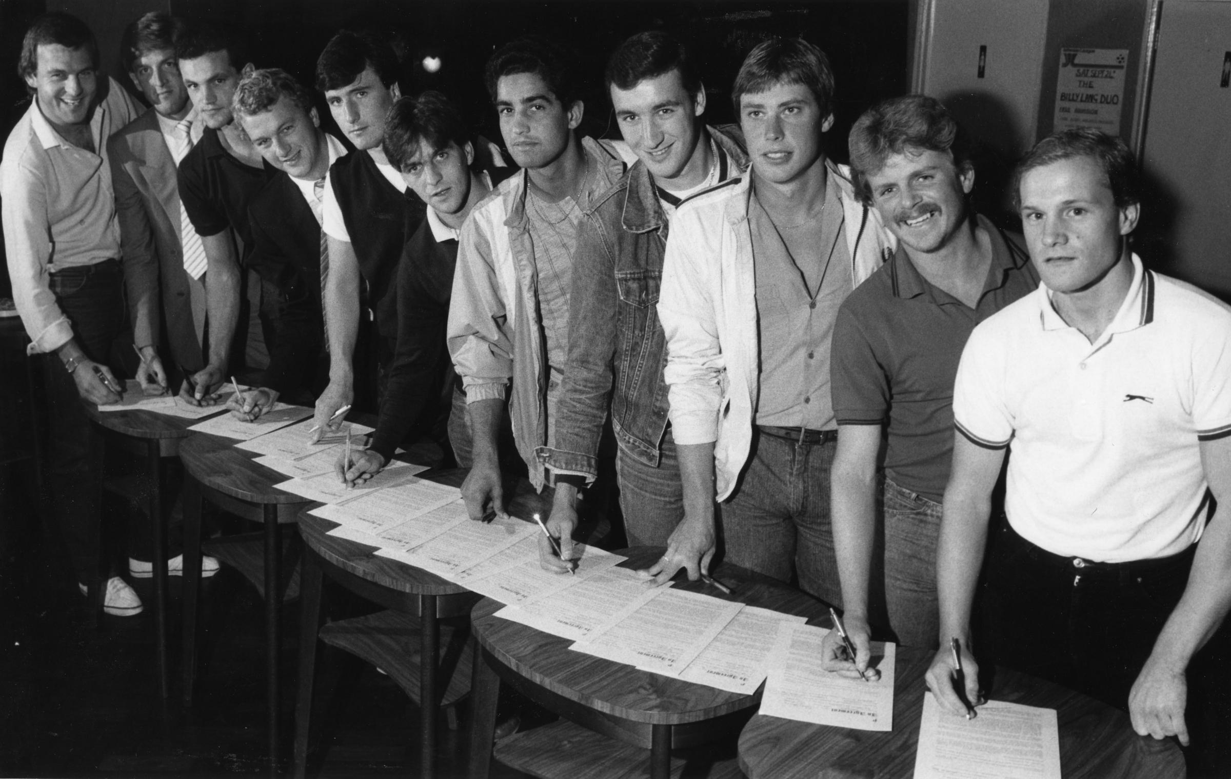 Some of Worthing's class of 1982 sign autographs. From left Geoff Raynsford, Mike Cornwell, Trevor Dove, Bruce Aitken, Danny Deans, Jimmy Quigg, Kevin Foreman, Paul Lelliott, Mick Edmonds, Russell Cox and Martin Cox