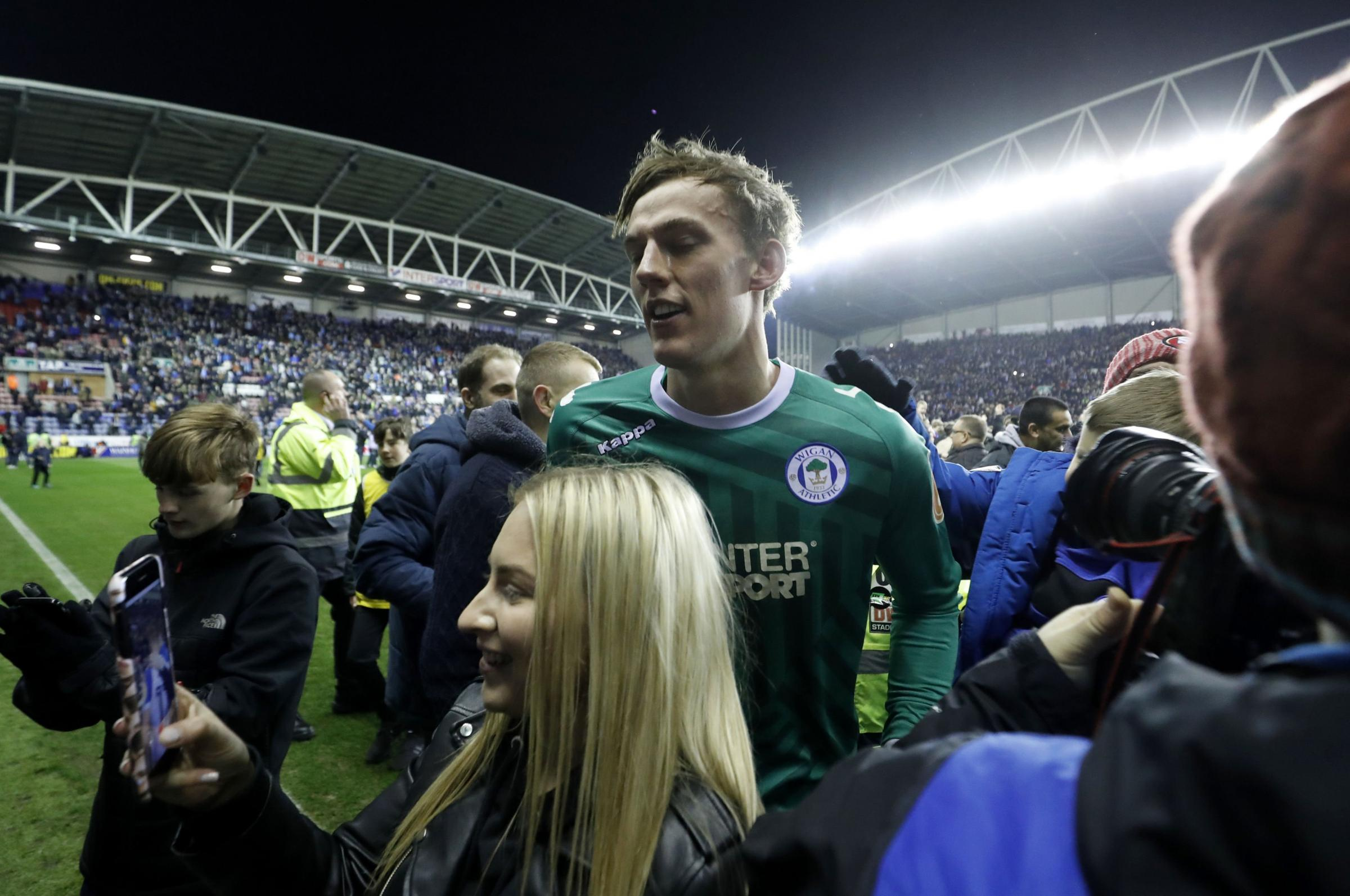 Christian Walton is all smiles after helping Wigan dump Manchester City out of the FA Cup