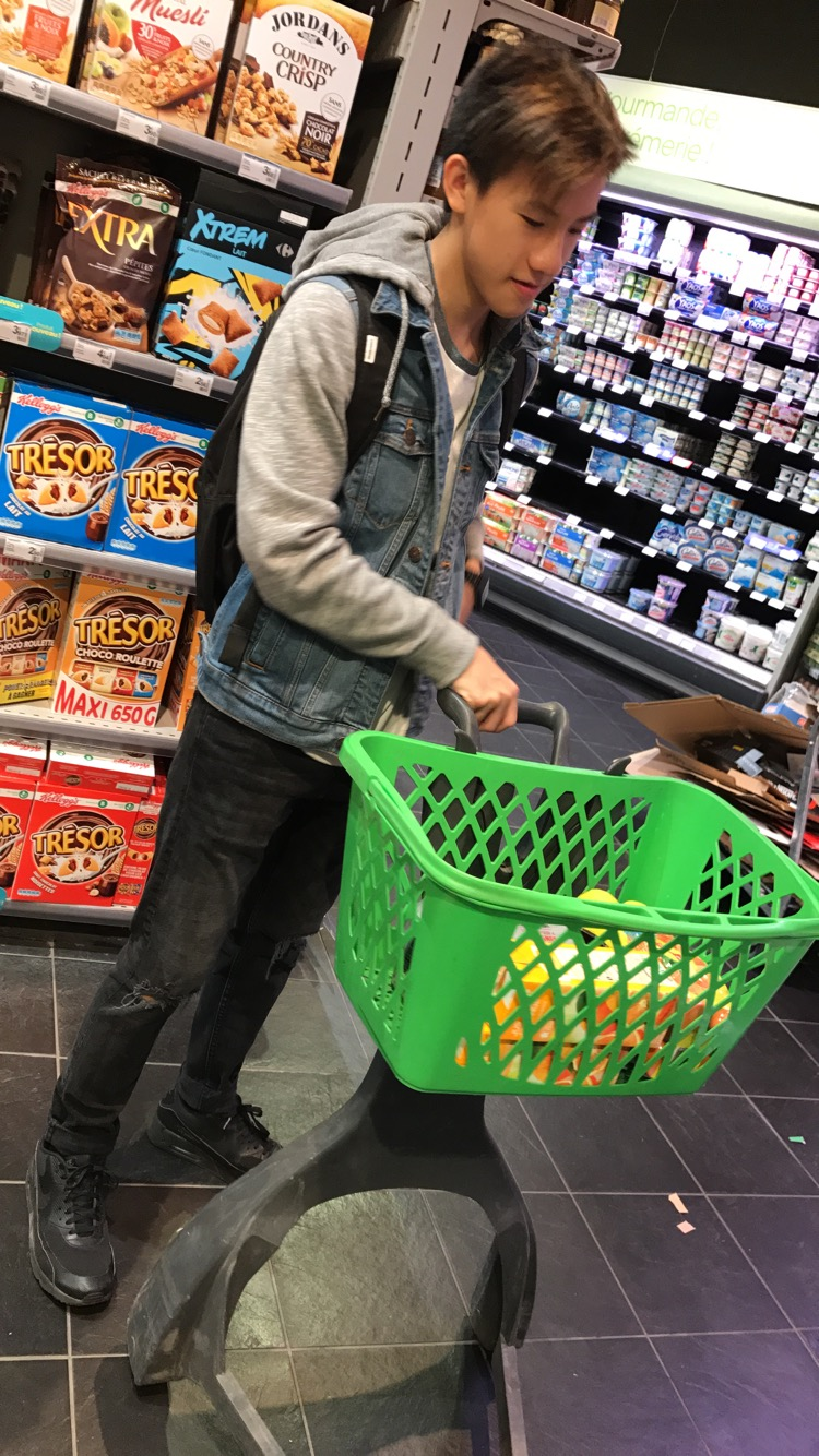 Harry Cheung. 17. Shopping for ingredients to make a Chinese meal for Steyning Grammar School Boarders