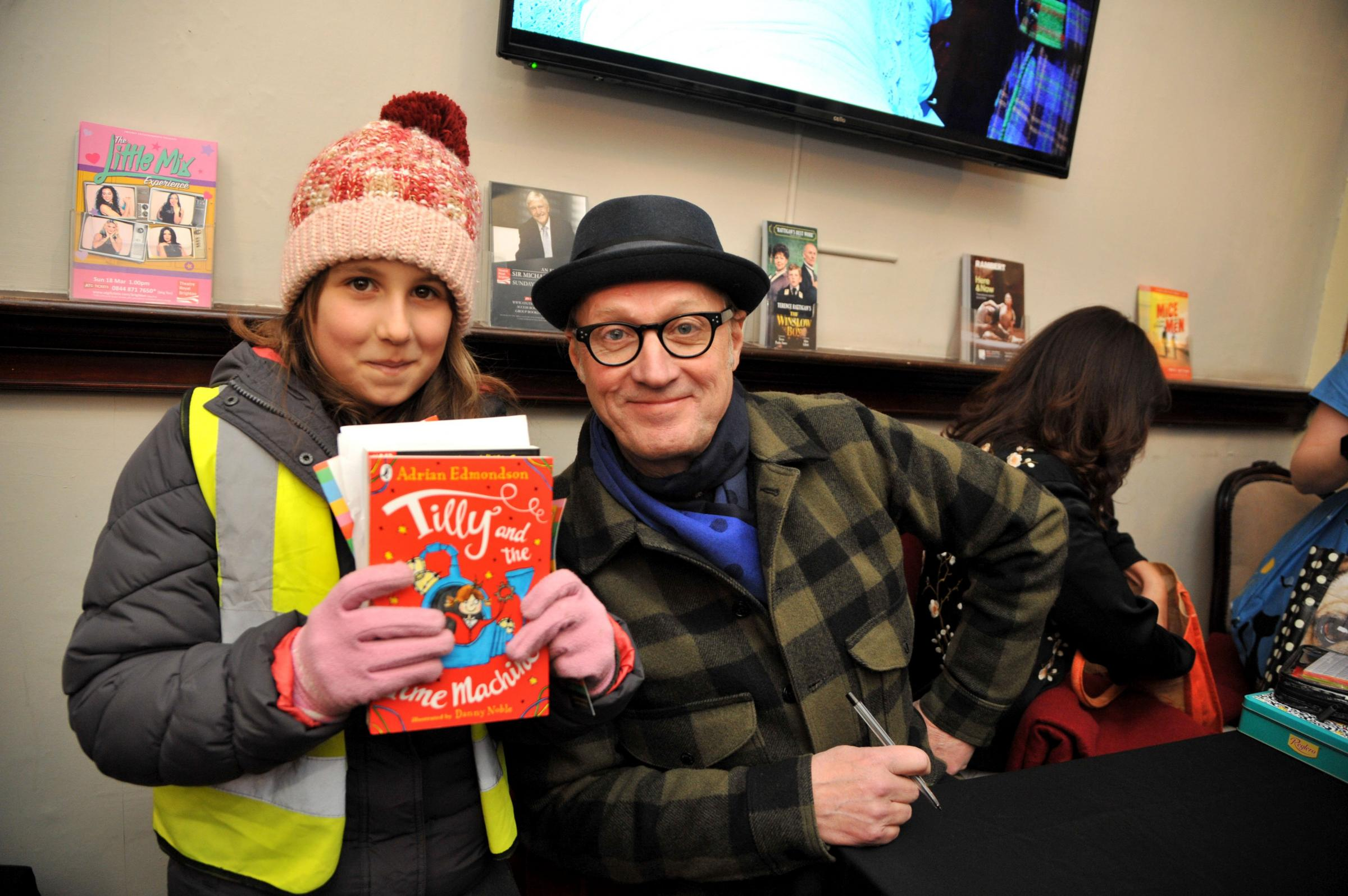 Lucia Wight, 11, from Mile Oak Primary School, with Adrian Edmondson