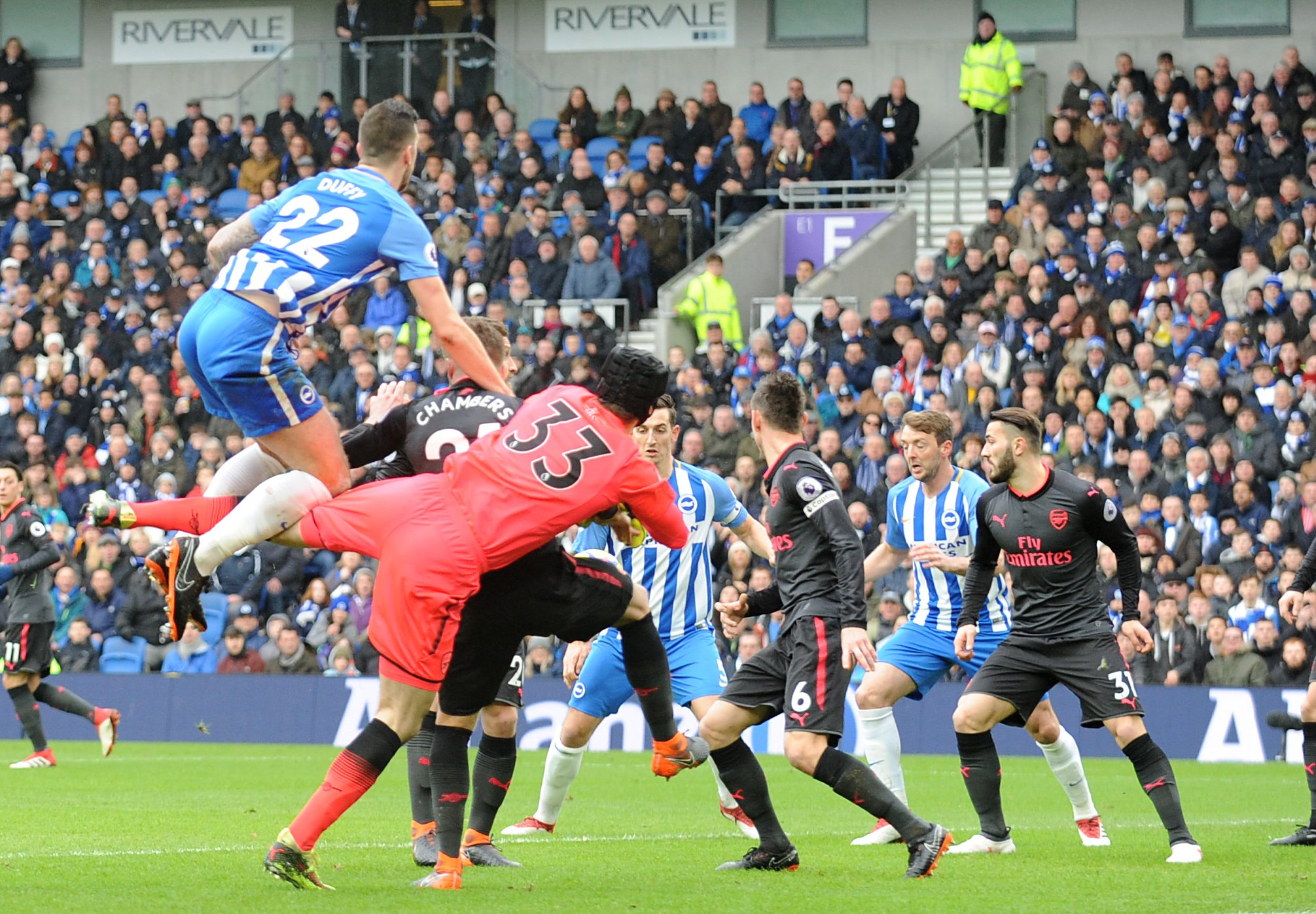 Shane Duffy (left) soars above Petr Cech to set up Lewis Dunk's breakthrough for Albion against Arsenal. Picture Liz Finlayson