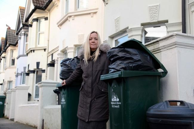 Residents' anger as over flowing bins left uncollected on streets
