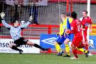 Thomas Pinault watches his strike fly past the keeper for Crawley