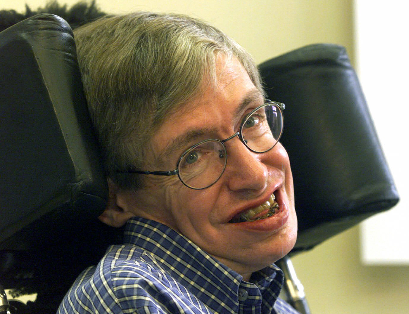 FILE - In this Wednesday, July 21, 1999 file photo Professor Stephen Hawking smiles during a news conference at the University of Potsdam, near Berlin, Germany. Hawking, whose brilliant mind ranged across time and space though his body was paralyzed by di