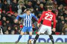 Solly March takes on Luke Shaw. Picture Richard Parkes
