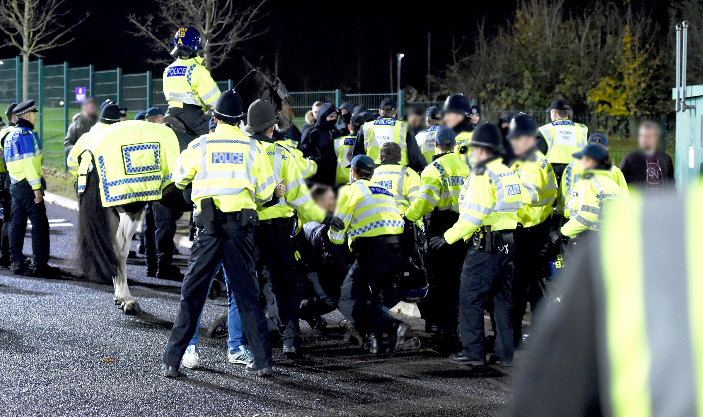 Police keep fans apart after Albion v Palace in November 2017
