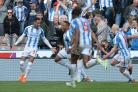 Huddersfield's Tom Ince (left) celebrates scoring his late winner against Watford (Dave Howarth/PA).