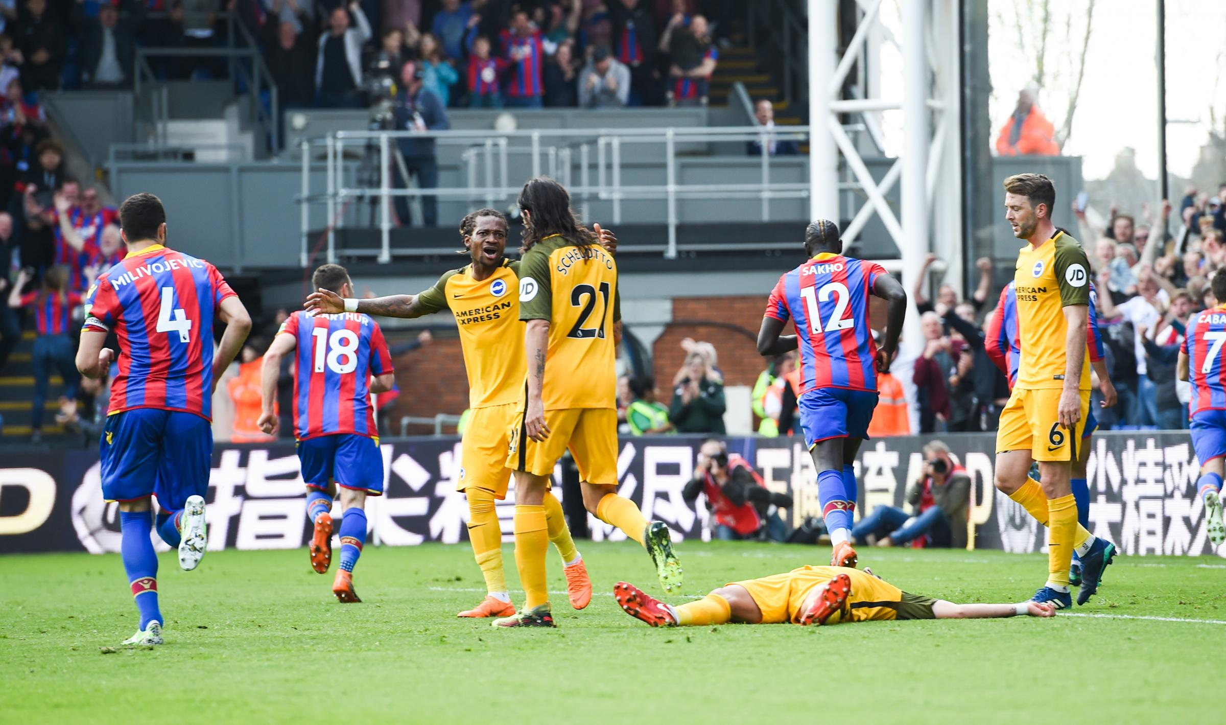 Gaetan Bong (centre) shows his dismay after poor Albion defending allows Wilfried Zaha to head in his second goal of the game. Picture Simon Dack