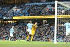 Leo Ulloa scoring at Manchester City. Pictures by Richard Parkes