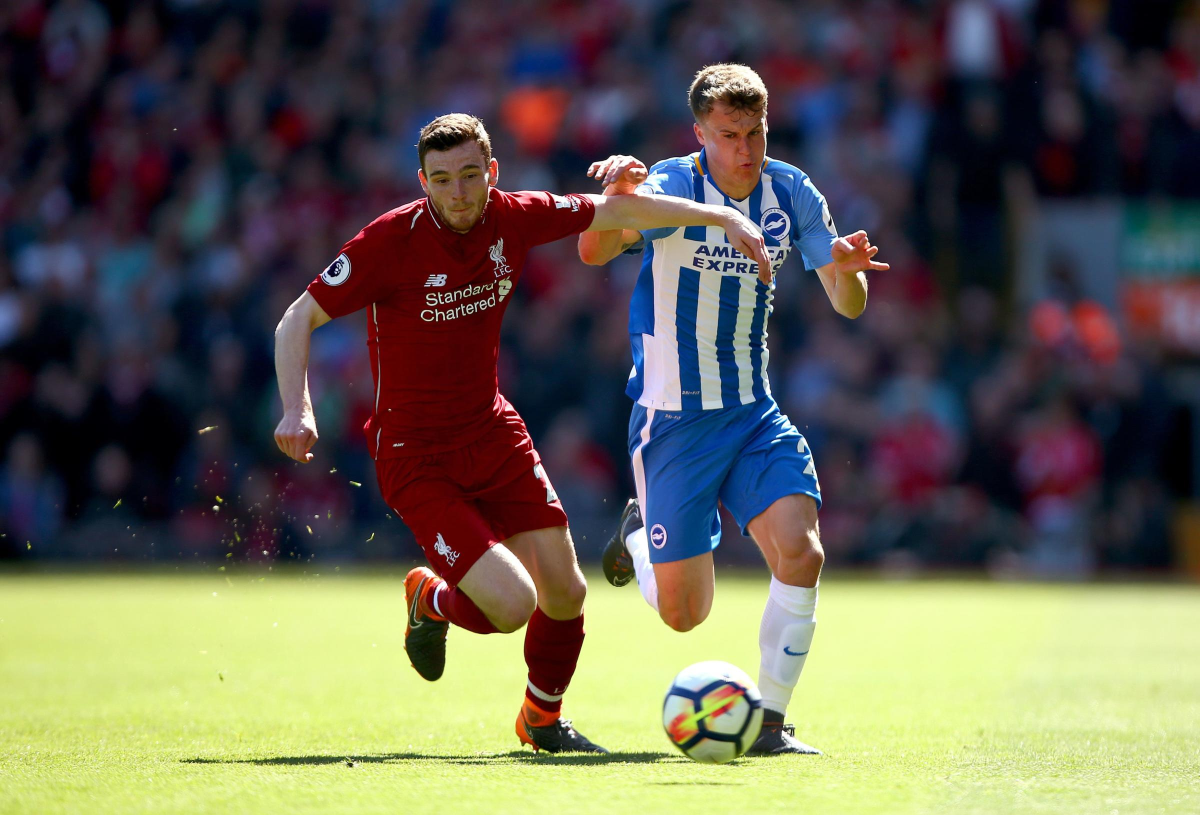 Solly March takes on Andy Robertson at Anfield