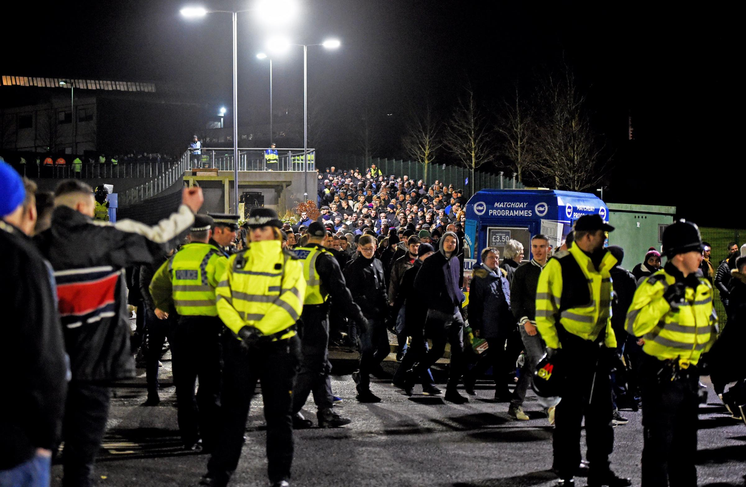 Police keep fans apart at the Albion v Palace match. Picture: Simon Dack